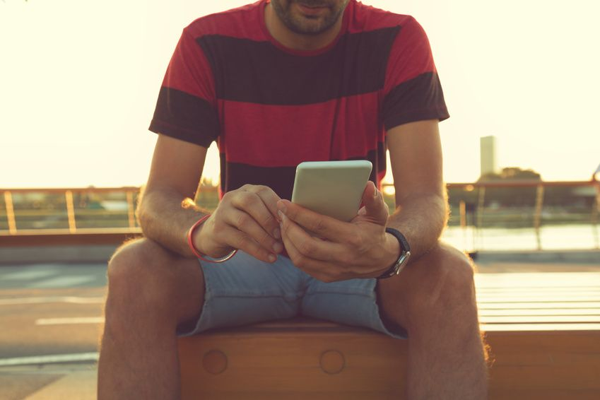 A man using a dating app on his mobile in search of a partner